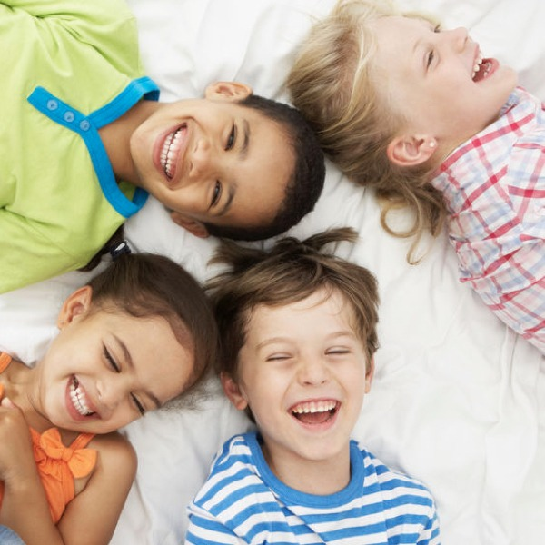 smiling kids lying in circle