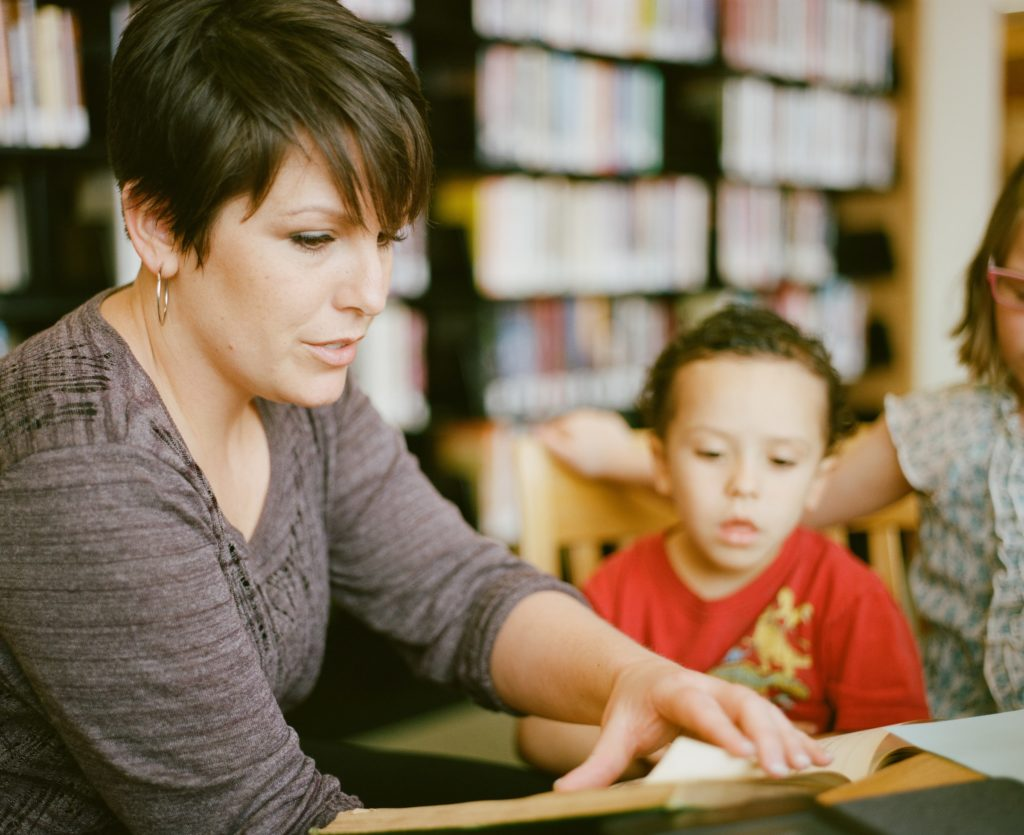 educator reading to small child