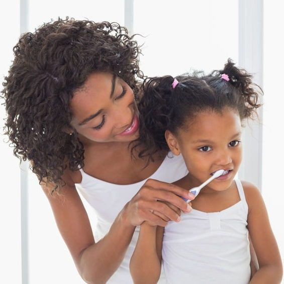 Mother helps care for child's teeth